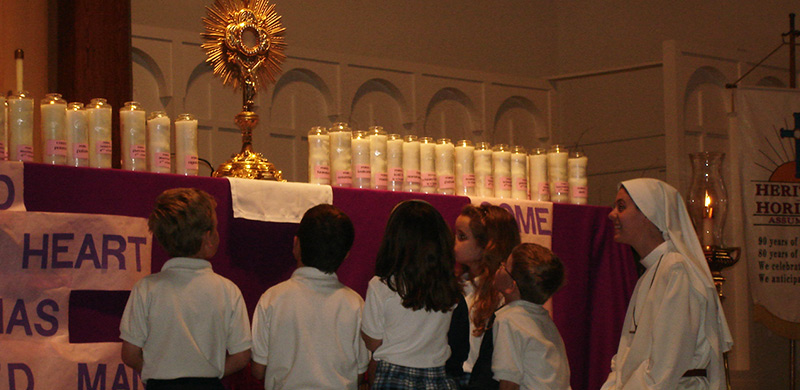 Sr. Clare with Children before the Blessed Sacrament
