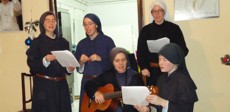 Sr. Stacy singing with Sr. Clare and other sisters