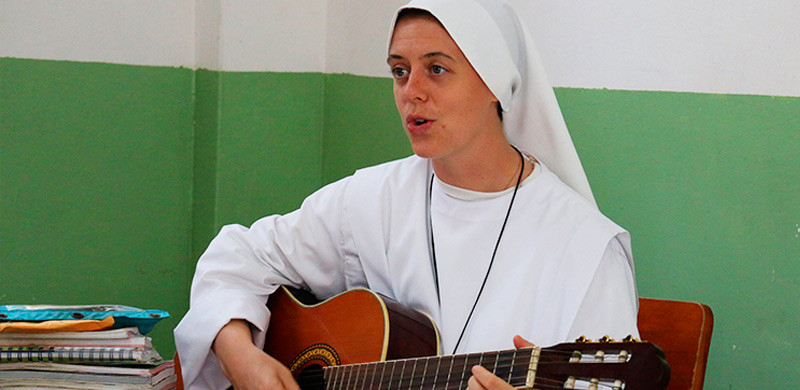 Sr. Clare playing the guitar